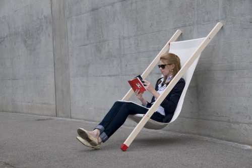 Leaning summer deck chair